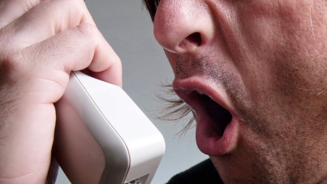 A man screaming on the phone