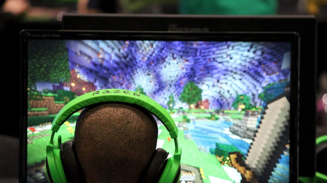 Child plays video game Minecraft at the Minecon convention in London
