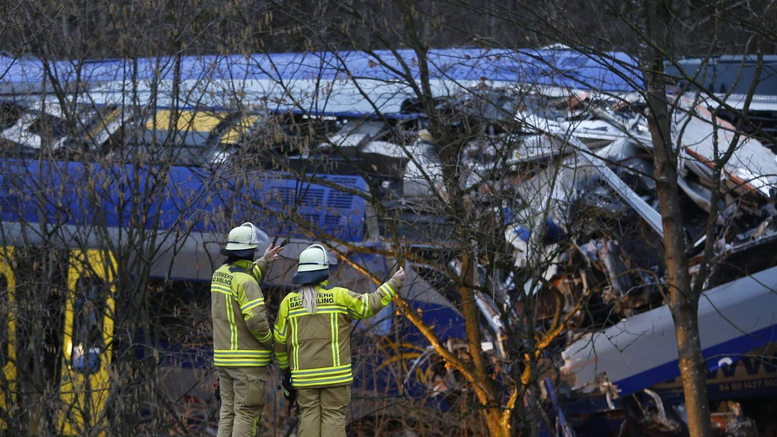 Rescue workers at the scene of the rail crash near Bad Aibling, Germany