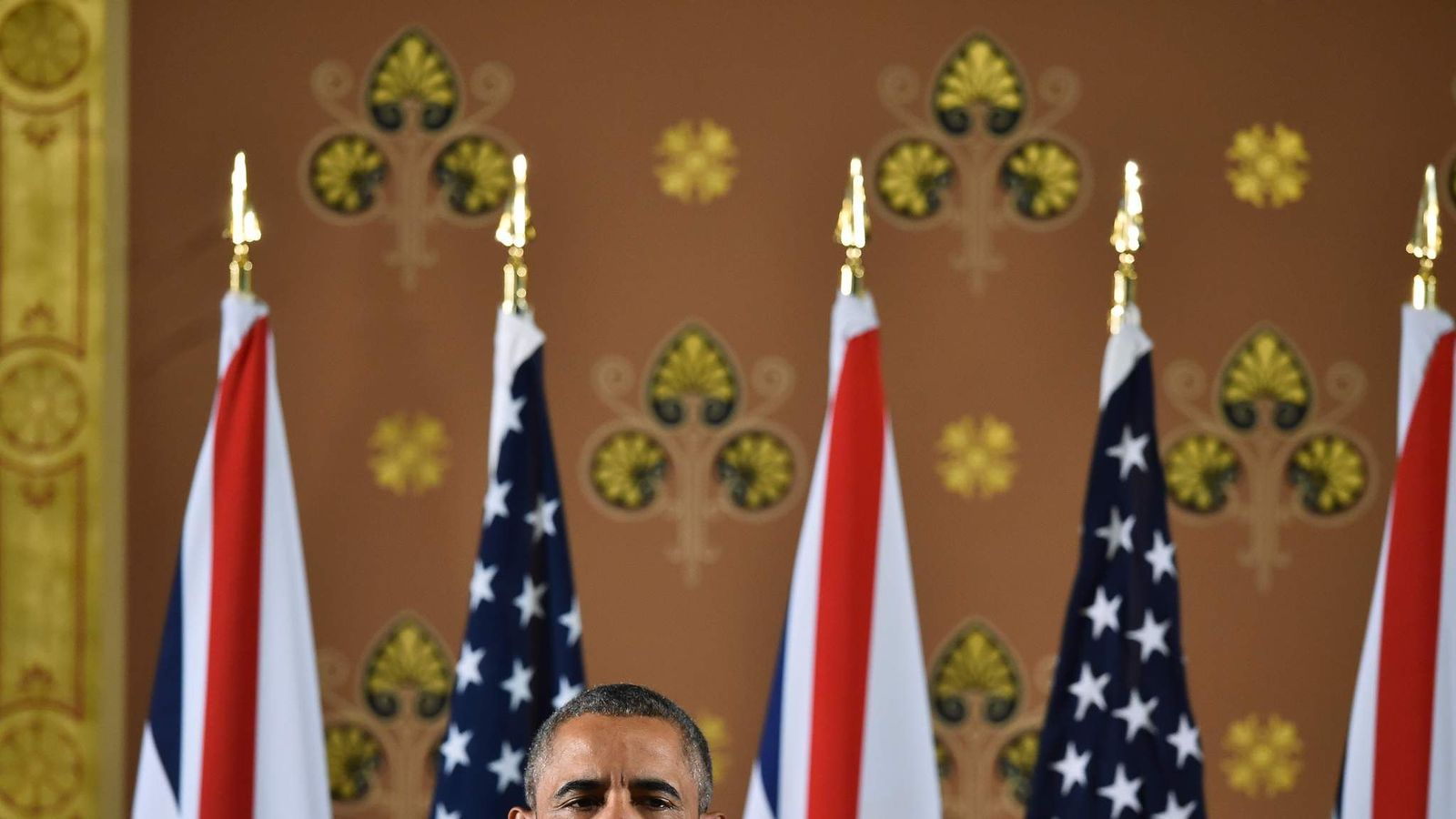 US President Barack Obama speaks during a press conference at the Foreign and Commonwealth Office in central London with Britain's Prime Minister David Cameron (unseen) following a meeting at Downing Street, in London