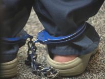 One of the girls shackled as she listens to proceedings in court