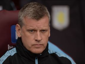 Aston Villa's Scottish caretaker manager Eric Black looks on during the English Premier League football match between Aston Villa and Chelsea at Villa Park