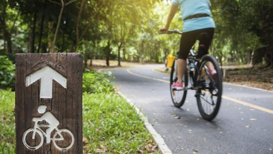 A bicycle is riden along a cycling path