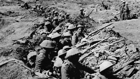 British infantrymen occupying a shallow trench during the Battle of the Somme