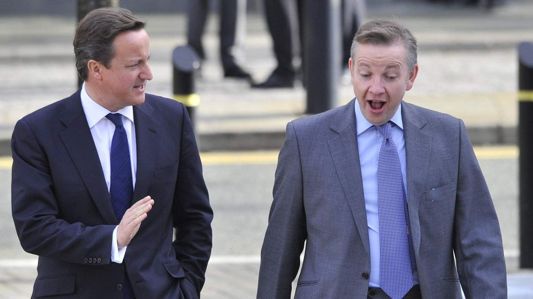 Britain's Prime Minister Cameron and Education Secretary Gove walk to the conference halls on the third day of the Conservative Party's annual Conference in Manchester
