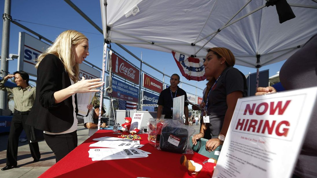 People browse booths at a military veterans' job fair in Carson