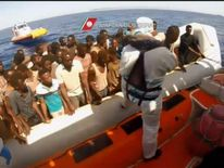 Migrants rescued from capsized boat