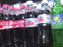 Bottles of Coca-Cola and other fizzy drinks on a shelf