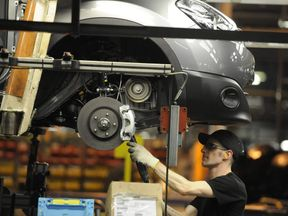 A Nissan technician prepares a Qashqai car at the company's plant in Sunderland