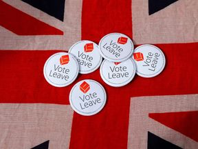 Badges are displayed on a Union flag during a Vote Leave rally in Exeter