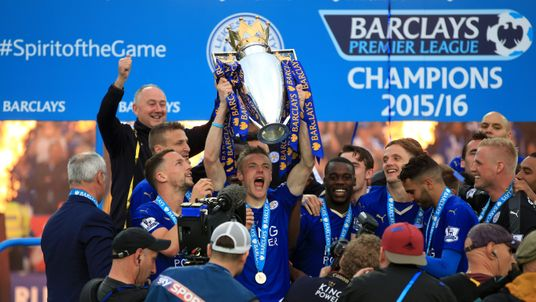 Leicester City's Jamie Vardy lifts the Premier League trophy