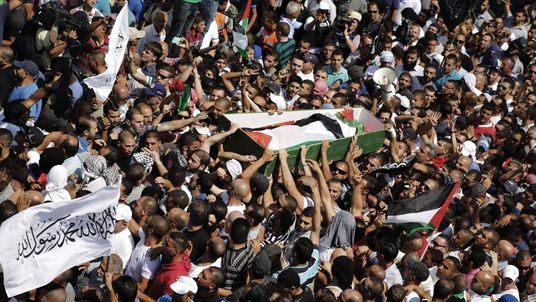 Palestinians carry the body of Mohammed Abu Khudair during his funeral in Shuafat