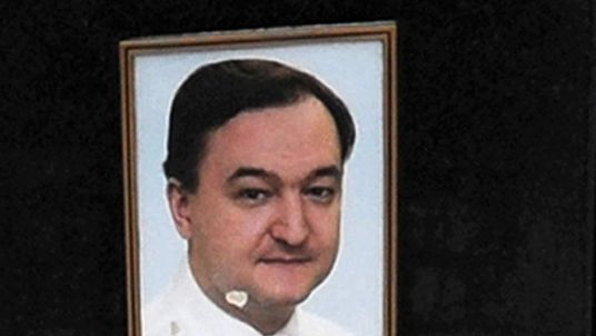 A close up of Russian lawyer Sergei Magnitsky's portrait on the grave