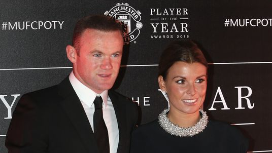 Wayne Rooney of Manchester United arrives with his wife Coleen Rooney at the club's annual Player of the Year awards at Old Trafford