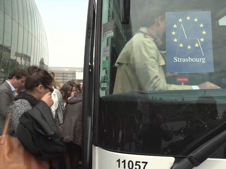 European parliament workers are taken by bus to Strasbourg offices