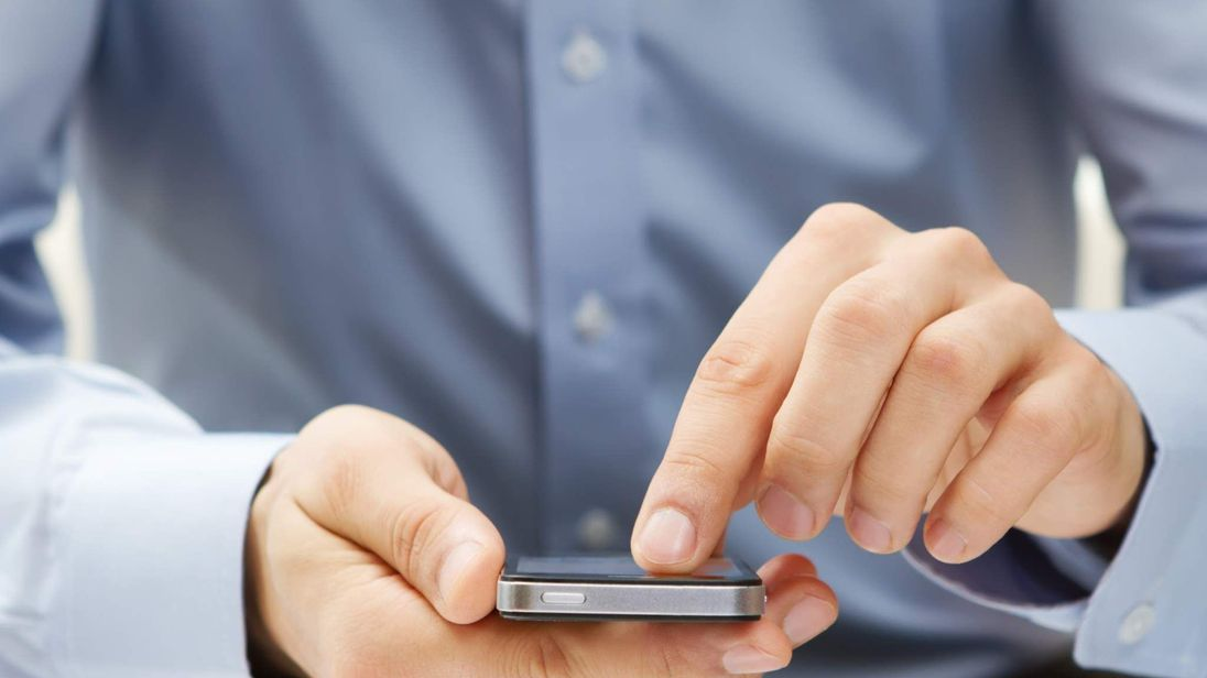 Close up of a man using smart phone