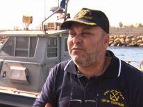 Libyan coastguard's head of operations Colonel Tawfik Alskir talking to Alex Rossi