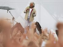 Leader of the Five Star Movement and comedian Grillo gestures while speaking during an election campaign for European Parliament elections in Rome