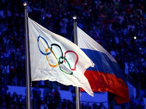 The Olympic flag and the Russian flag