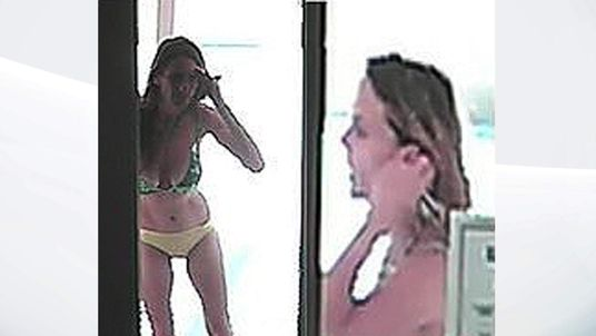 Police in California are hunting for a bikini-clad woman who broke into two homes and took items
