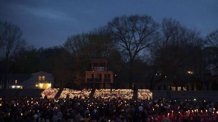 People gather at Jonathan Law High School for a vigil for Maren Sanchez