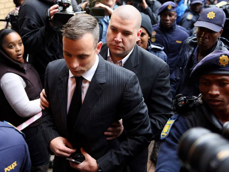Former Paralympian Oscar Pistorius arrives to be sentenced for murder of his girlfriend Reeva Steenkamp at the Pretoria High Court