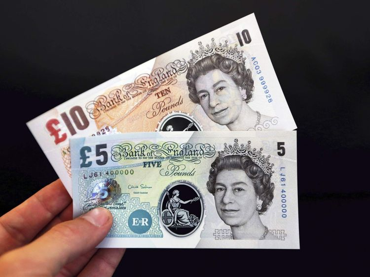 Sample polymer five and ten GB pound banknotes are displayed at the Bank of England in London