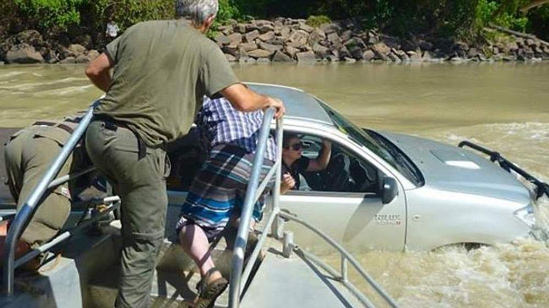 woman rescued from car trapped in crocodile infested river