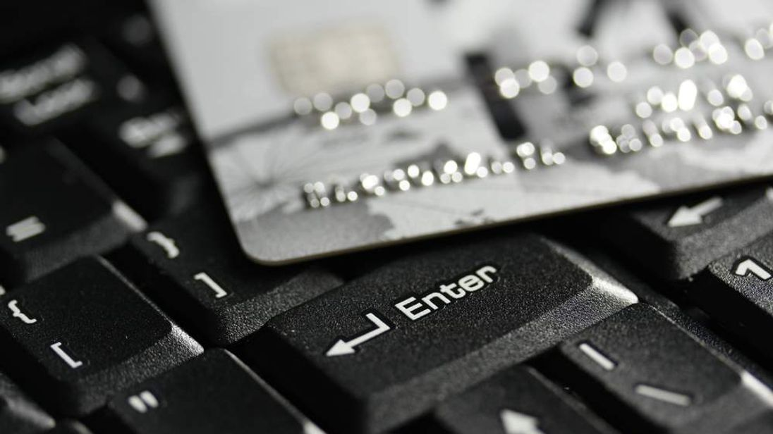 A credit card on a computer keyboard