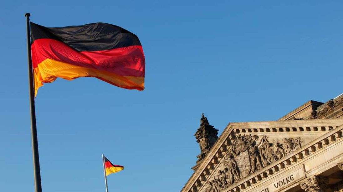 The German flag flys outside the Reichst