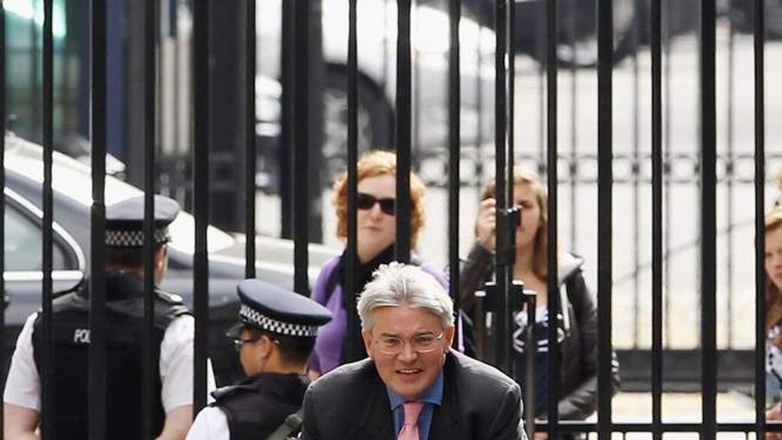 Chief Whip Andrew Mitchell On Bike In Downing Street