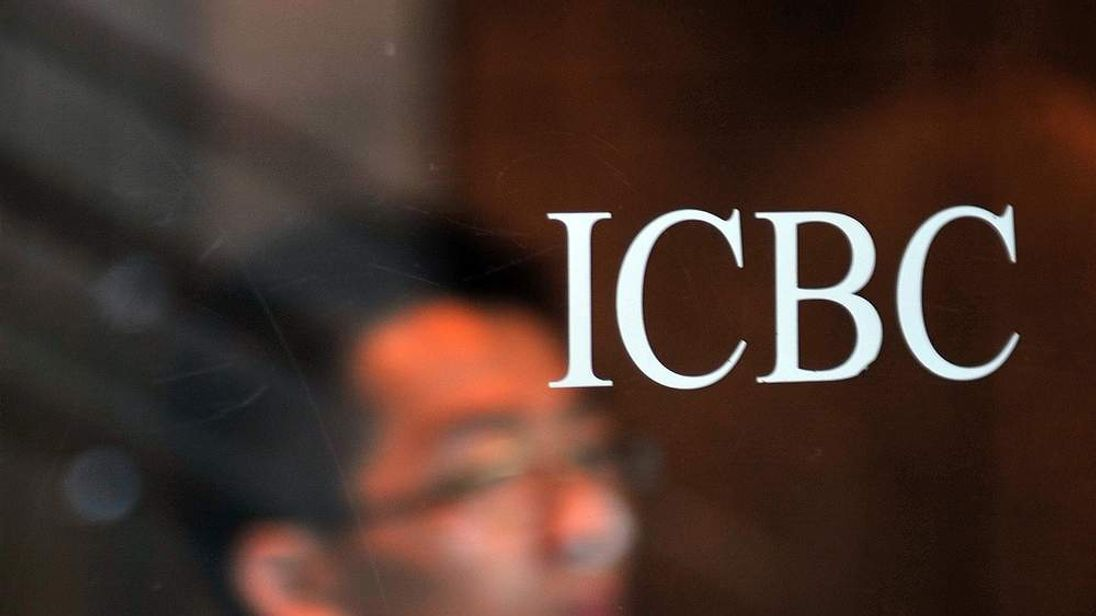 An office worker leaves the Industrial and Commercial Bank of China (ICBC) headquarters