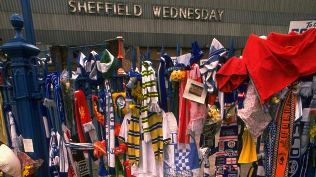 Tributes cover a fence and path in the aftermath of the disaster at Hillsborough