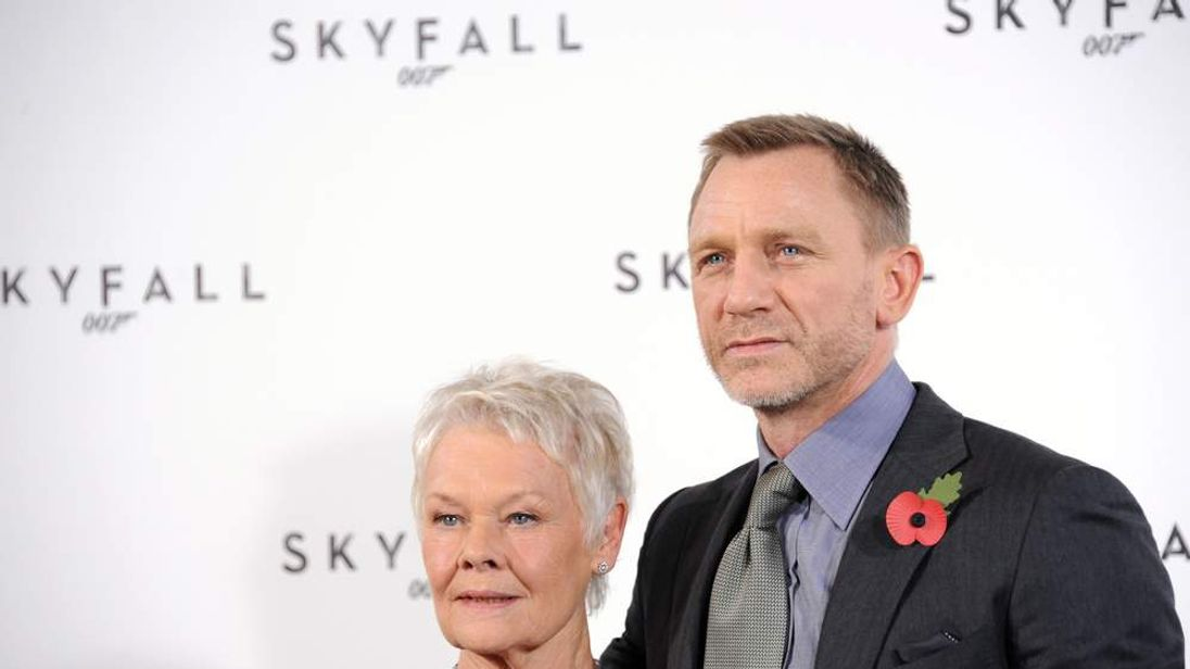 Dame Judi Dench and Daniel Craig at a Skyfall photocall