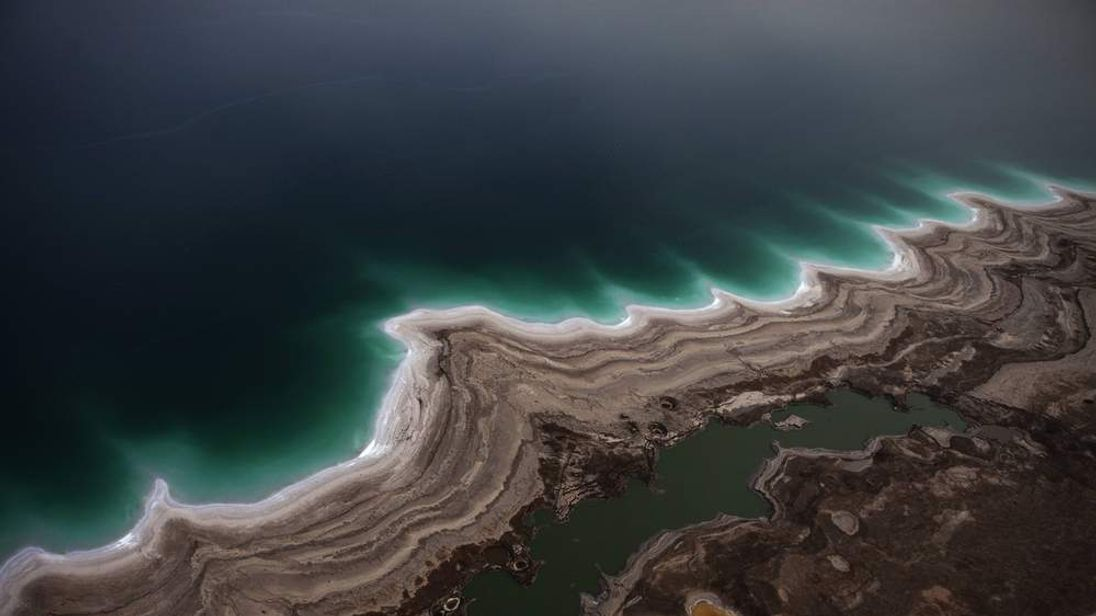 An aerial view photo shows sinkholes created by the drying of the Dead Sea
