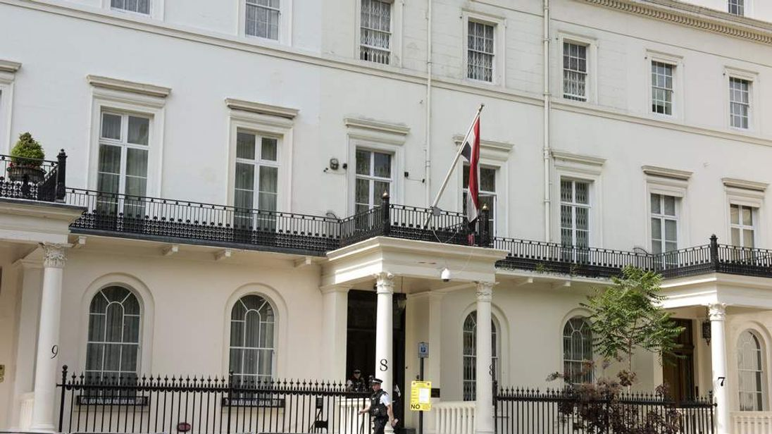 British police officers stand outside the Syrian Embassy in London