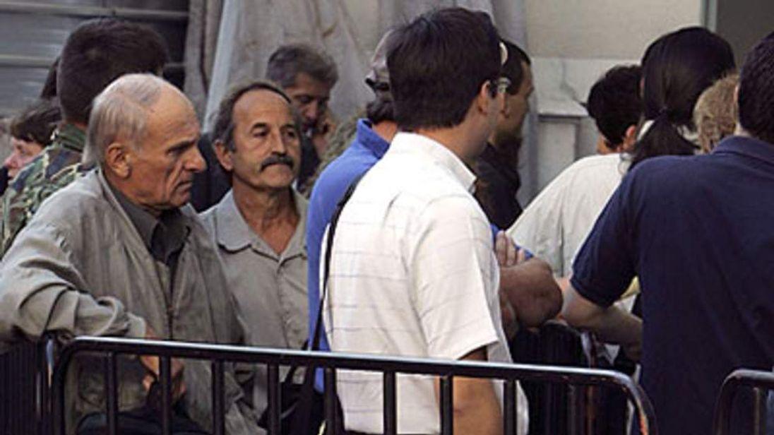 Migrants Queue For Visa