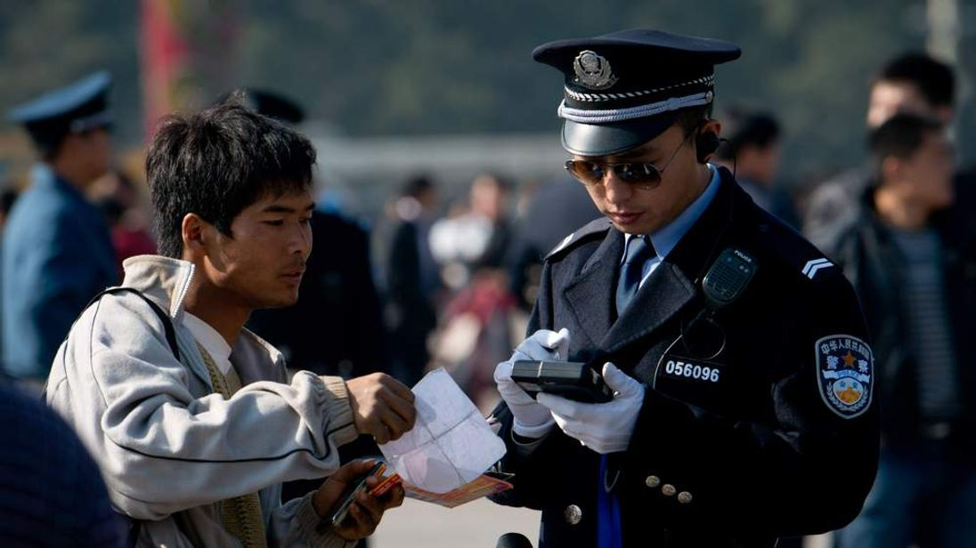 Man has documents checked in Beijing ahead of Communist congress