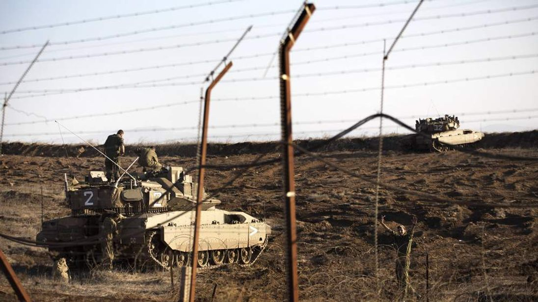 Israeli tank in Golan Heights overlooking Syrian village of Breqa