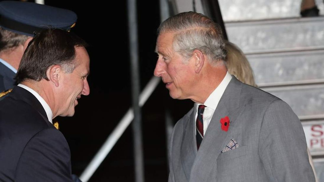 Prince Charles, Prince of Wales greets New Zealand Prime Minister John Key
