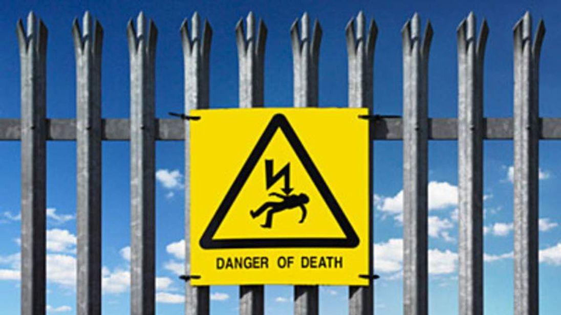 Sign reading Warning Danger of Death
