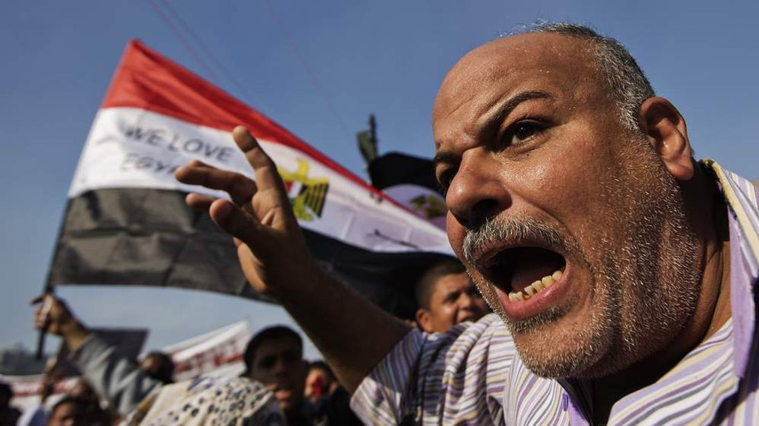 An Egyptian man protests in Cairo's Tahrir Square