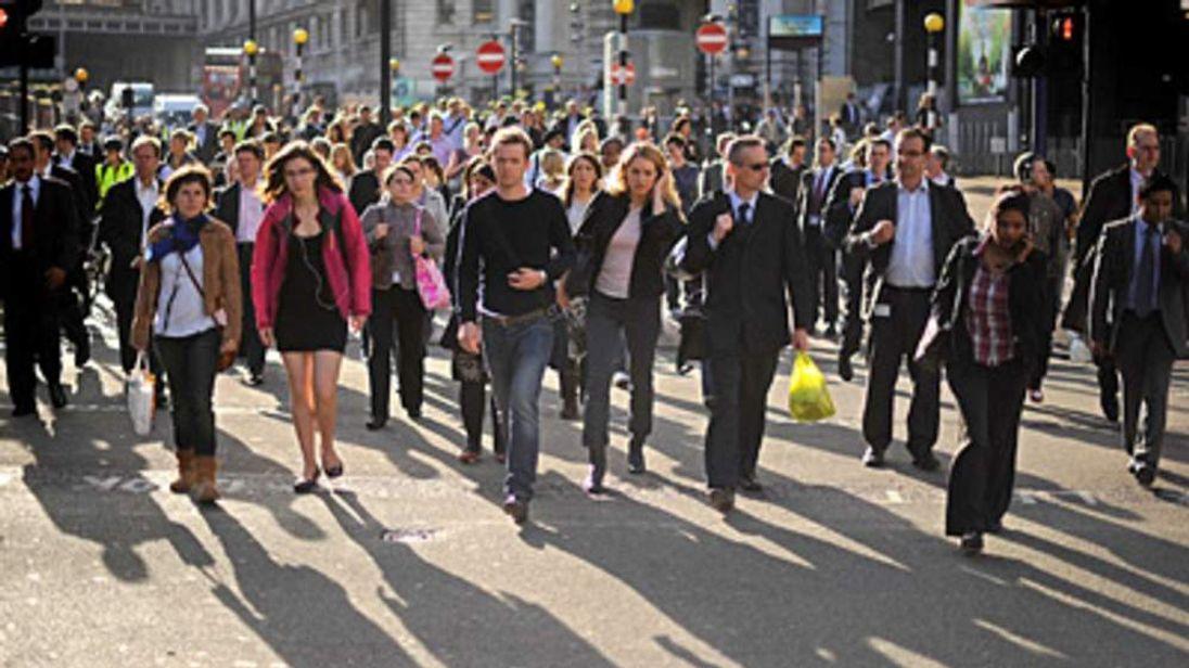 Commuters walk from Waterloo station, London