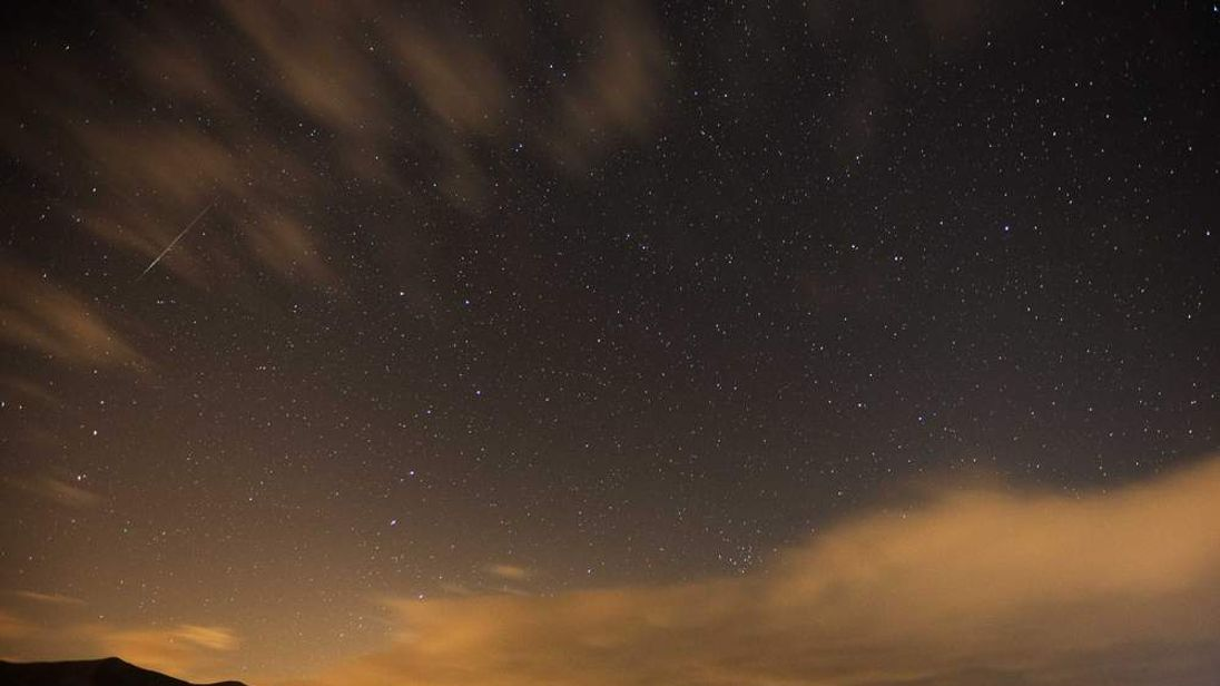 Geminid meteor streaks are seen above the Judean desert near the Israeli Kibbutz of Ein Gedi