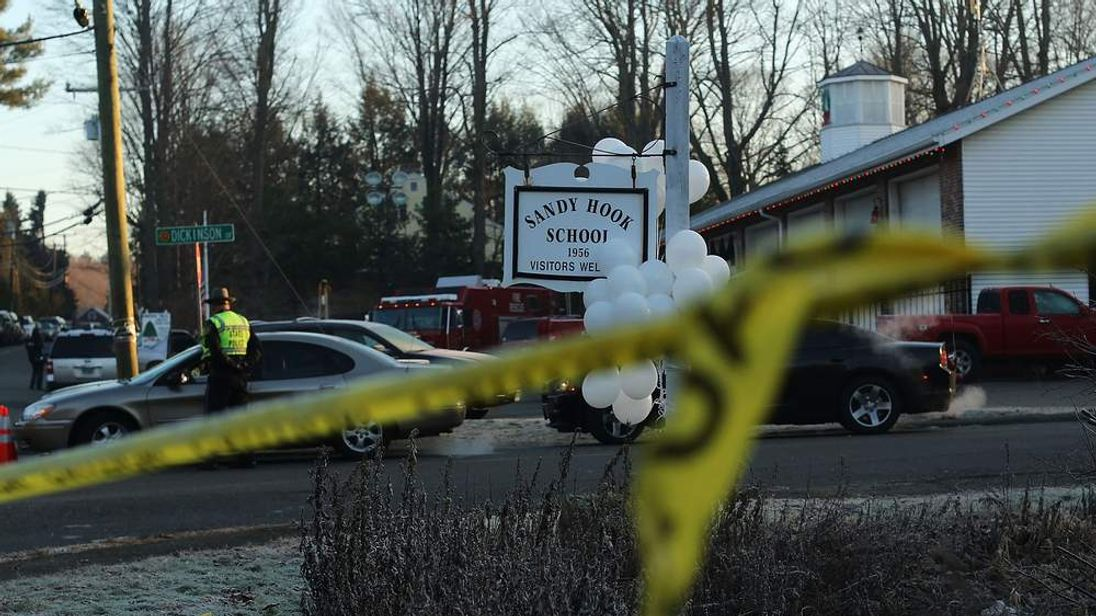 Police tape outside the entrance to the Sandy Hook Elementary School