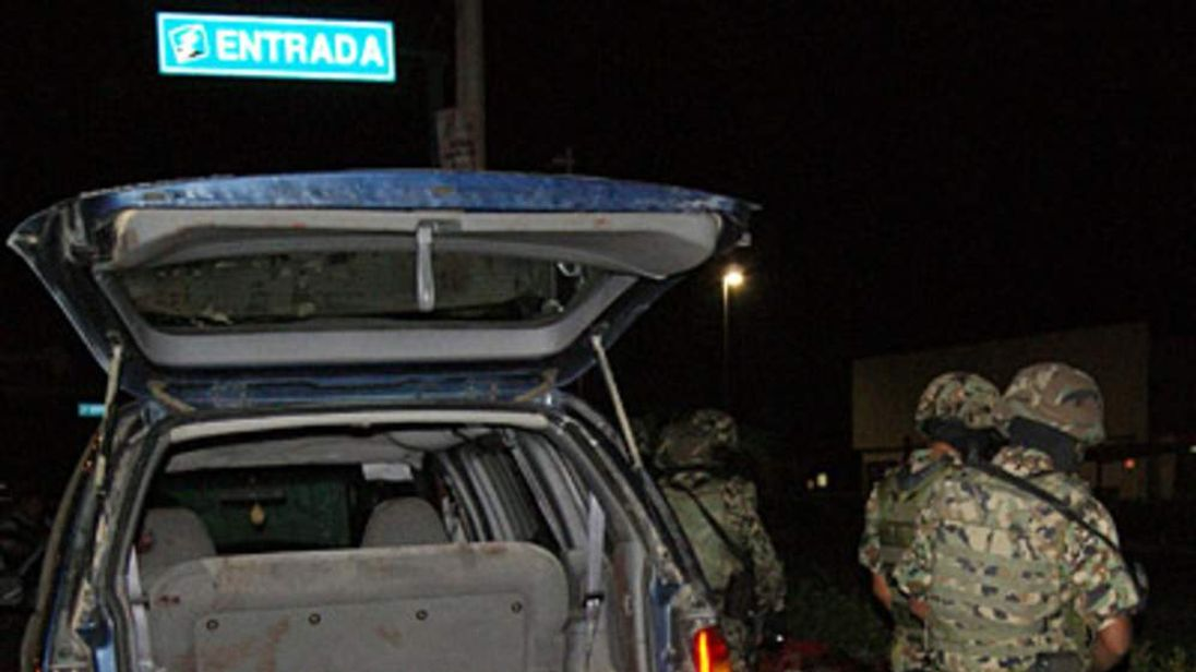 Members of the Mexican Navy look at bodies discovered in Acapulco