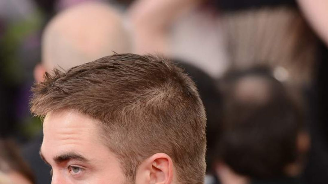 Robert Pattinson arrives at the 70th Annual Golden Globe Awards