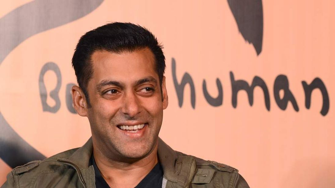 Bollywood film actor Salman Khan smiles during the launch of his 'Being Human' flagship clothing store in Mumbai on January 17, 2013. Khan announced the pan-India launch of his flagship retail store for 'Being Human' fashion apparel after having already launched in Paris, Belgium, Spain and Dubai. AFP PHOTO/ INDRANIL MUKHERJEE (Photo credit should read INDRANIL MUKHERJEE/AFP/Getty Images)