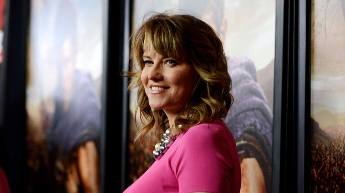 Lucy Lawless arrives at the premiere of Spartacus: War Of The Damned
