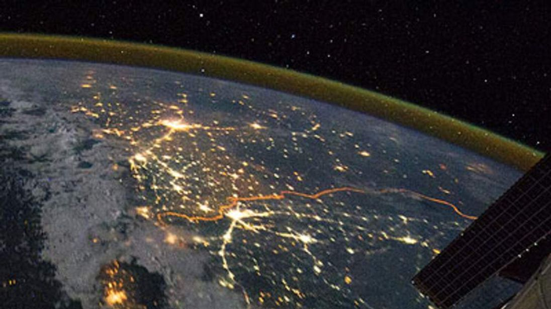 The India-Pakistan border appears as an orange line in this photograph taken by the Expedition 28 crew on the International Space Station (ISS) on August 21, 2011 and released September 4, 2011.